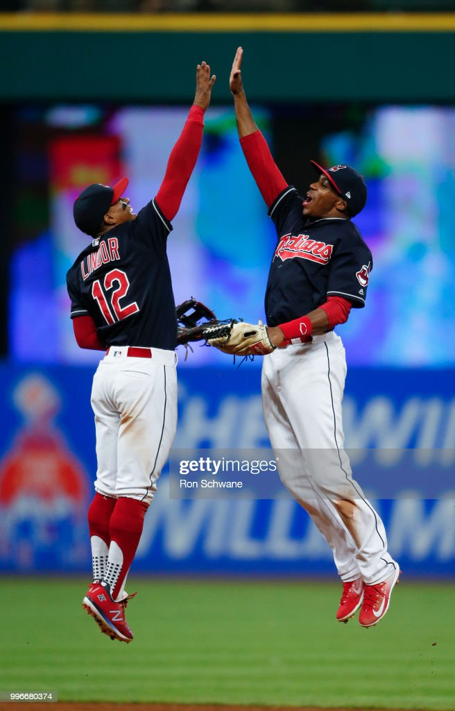 Francisco Lindor #12 and Greg Allen #1 of the Cleveland Indians celebrate a 19-4 victory over the Cincinnati Reds at Progressive Field on July 11, 2018 in Cleveland, Ohio.
