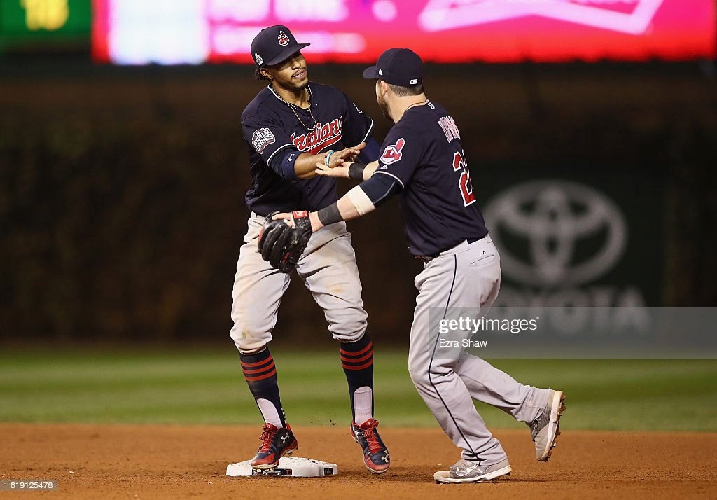Francisco Lindor #12 and Jason Kipnis #22 of the Cleveland Indians celebrate after beating the Chicago Cubs 7-2 in Game Four of the 2016 World Series at Wrigley Field on October 29, 2016 in Chicago, Illinois.