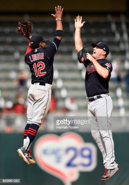 Francisco Lindor and Jay Bruce of the Cleveland Indians celebrate winning game one of a doubleheader against the Minnesota Twins on August 17 2017 at...