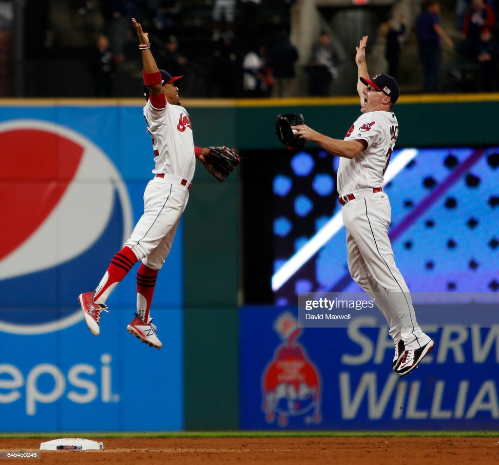 Francisco Lindor #12 and Jay Bruce #32 of the Cleveland Indians celebrate after defeating the Baltimore Orioles at Progressive Field on September 10, 2017 in Cleveland, Ohio. The Indians defeated the Orioles 3-2, and their win streak now stands at 18.