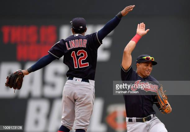Francisco Lindor and Leonys Martin of the Cleveland Indians celebrate defeating the Minnesota Twins after the game on August 1 2018 at Target Field...