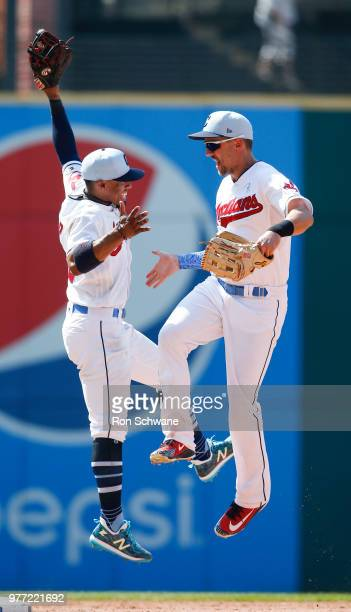 Francisco Lindor and Lonnie Chisenhall of the Cleveland Indians celebrate a 41 victory over the Minnesota Twins at Progressive Field on June 17 2018...