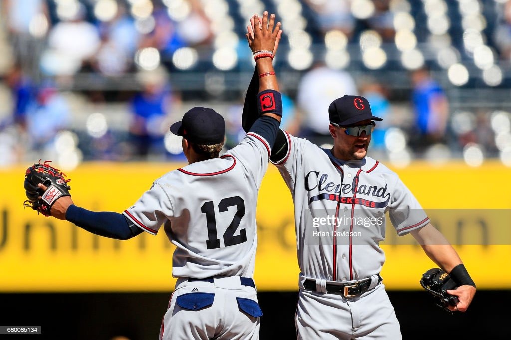 Francisco Lindor #12 and Lonnie Chisenhall #8 of the Cleveland Indians celebrate defeating the Kansas City Royals 1-0 at Kauffman Stadium on May 7, 2017 in Kansas City, Missouri.