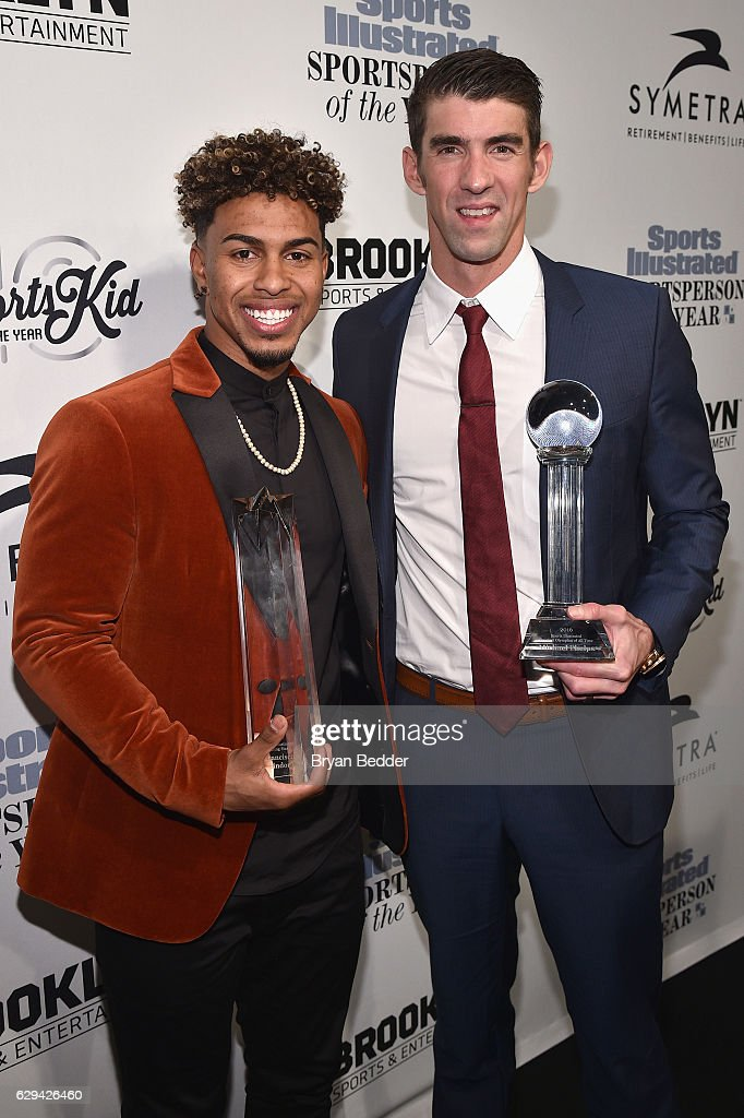 Francisco Lindor and Michael Phelps pose with their awards during the Sports Illustrated Sportsperson of the Year Ceremony 2016 at Barclays Center of Brooklyn on December 12, 2016 in New York City.