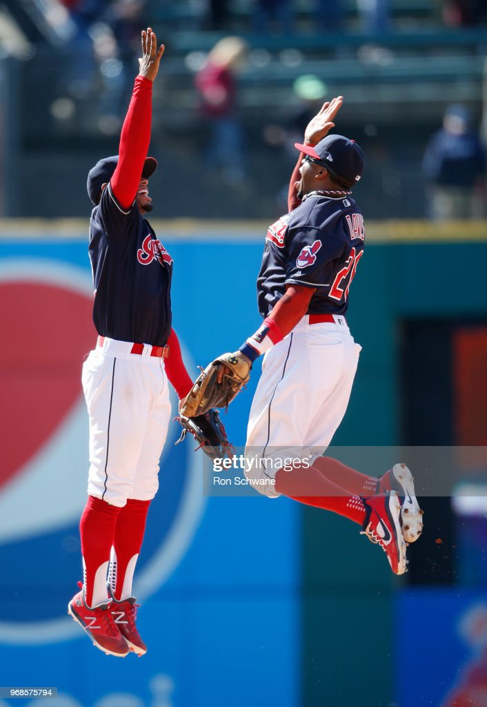 Francisco Lindor #12 and Rajai Davis #26 of the Cleveland Indians celebrate a 3-1 victory over the Milwaukee Brewers at Progressive Field on June 6, 2018 in Cleveland, Ohio.