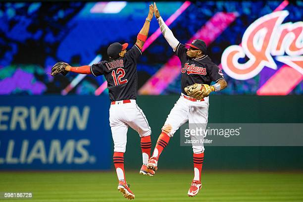 Francisco Lindor and Rajai Davis of the Cleveland Indians celebrate after the Indians defeated the Minnesota Twins at Progressive Field on August 31...
