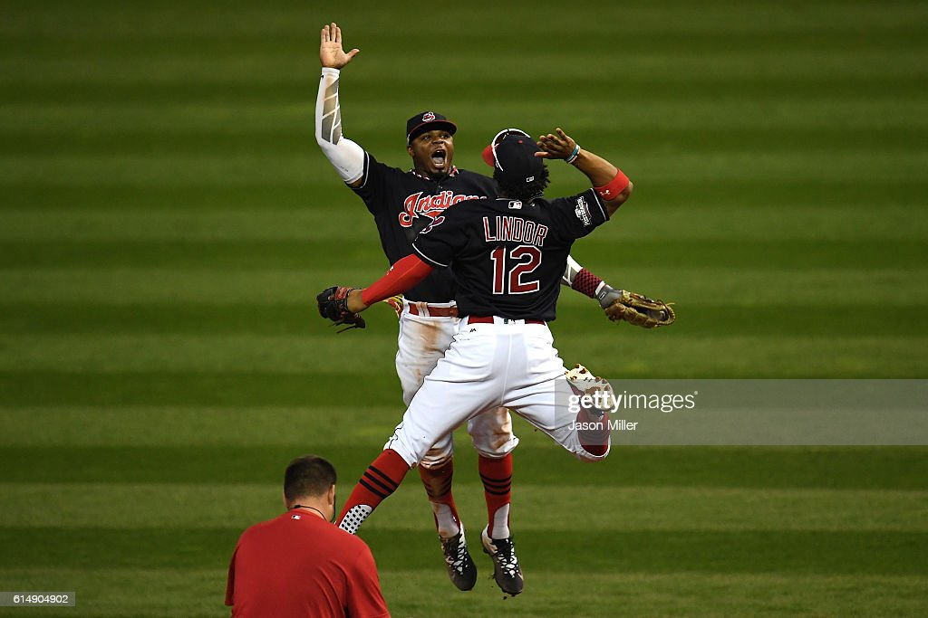 Francisco Lindor #12 and Rajai Davis #20 of the Cleveland Indians celebrate after defeating the Toronto Blue Jays with a score of 2 to 1 in game two of the American League Championship Series at Progressive Field on October 15, 2016 in Cleveland, Ohio.