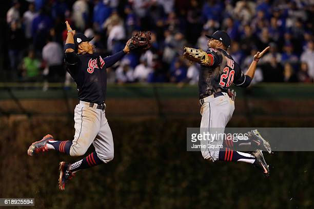 Francisco Lindor and Rajai Davis of the Cleveland Indians celebrate after defeating the Chicago Cubs 10 in Game Three of the 2016 World Series at...