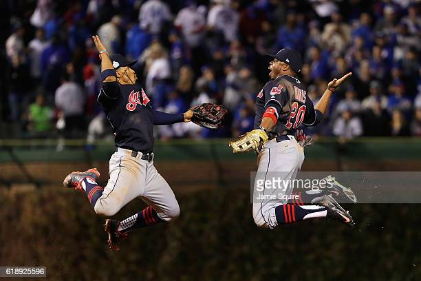 Francisco Lindor and Rajai Davis of the Cleveland Indians celebrate after defeating the Chicago Cubs 1-0 in Game Three of the 2016 World Series at...