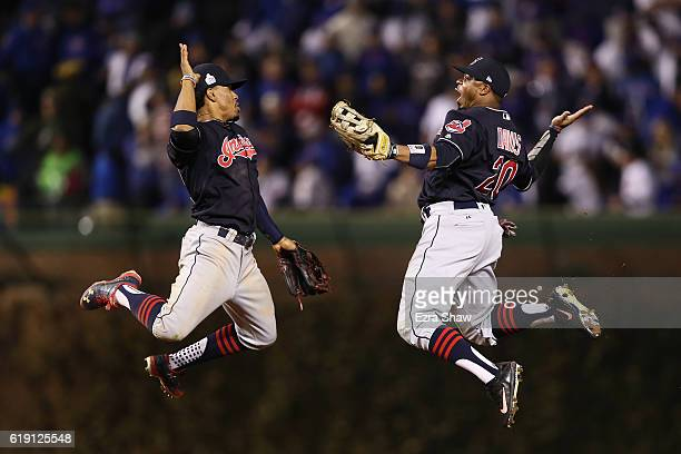 Francisco Lindor and Rajai Davis of the Cleveland Indians celebrate after beating the Chicago Cubs 7-2 in Game Four of the 2016 World Series at...