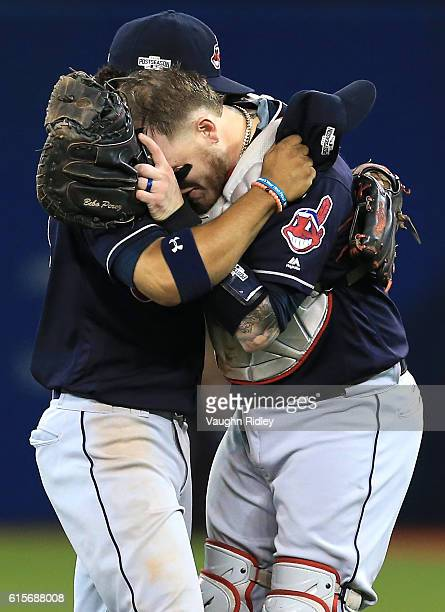 Francisco Lindor and Roberto Perez of the Cleveland Indians celebrate after defeating the Toronto Blue Jays with a score of 3 to 0 in game five to...