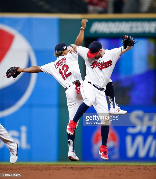 Francisco Lindor and Tyler Naquin of the Cleveland Indians celebrate an 8-0 victory over the Detroit Tigers at Progressive Field on July 16, 2019 in...