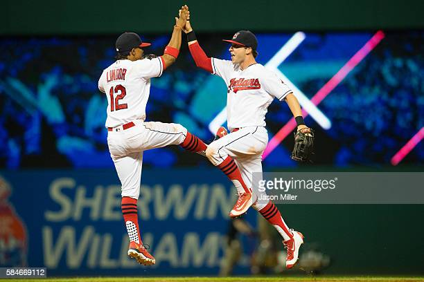 Francisco Lindor and Tyler Naquin of the Cleveland Indians celebrate after the Indians defeated the Oakland Athletics at Progressive Field on July 29...