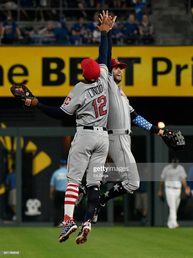 Francisco Lindor #12 and Tyler Naquin #30 of the Cleveland Indians celebrate a 3-2 win over the Kansas City Royals at Kauffman Stadium on July 4, 2018 in Kansas City, Missouri.