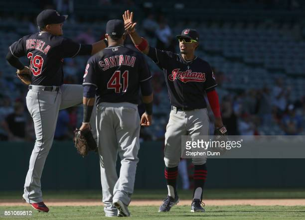 Francisco Lindor Carlos Santana a Giovanny Urshela of the Cleveland Indians celebrate after the game against the Los Angeles Angels of Anaheim on...