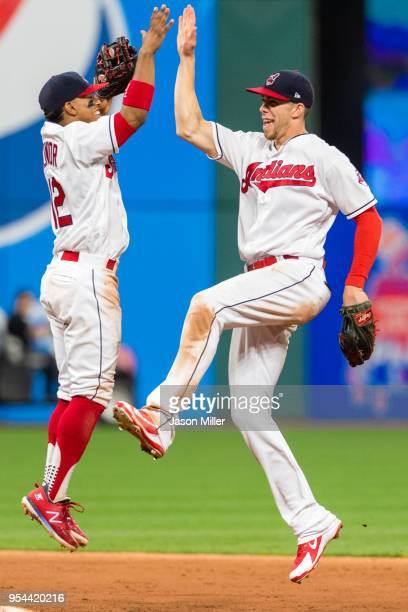 Francisco Lindor celebrates with Bradley Zimmer of the Cleveland Indians after the Indians defeated the Toronto Blue Jays in game two of a...