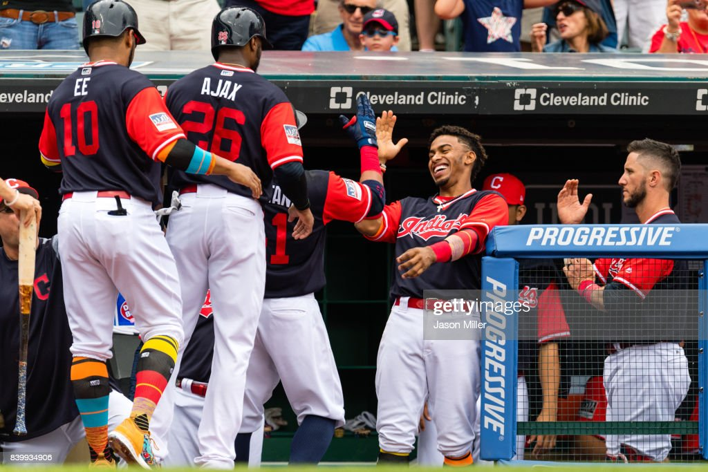 Francisco Lindor celebrates with Edwin Encarnacion #10 Austin Jackson Carlos Santana #41 of the Cleveland Indians after they scored on a Santana home run during the second inning against the Kansas City Royals at Progressive Field on August 27, 2017 in Cleveland, Ohio.
