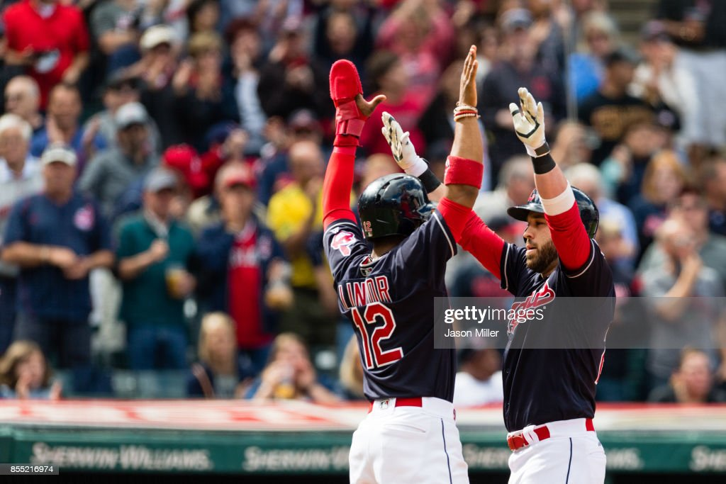 Francisco Lindor #12 celebrates with Jason Kipnis #22 of the Cleveland Indians after both scored on a home run by Kipnis during the sixth inning against the Minnesota Twins at Progressive Field on September 27, 2017 in Cleveland, Ohio.
