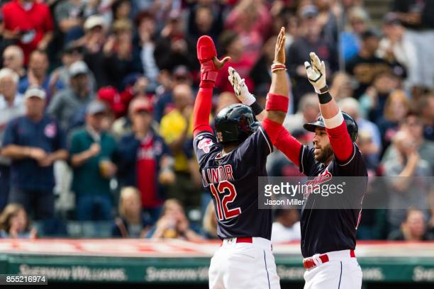 Francisco Lindor celebrates with Jason Kipnis of the Cleveland Indians after both scored on a home run by Kipnis during the sixth inning against the...