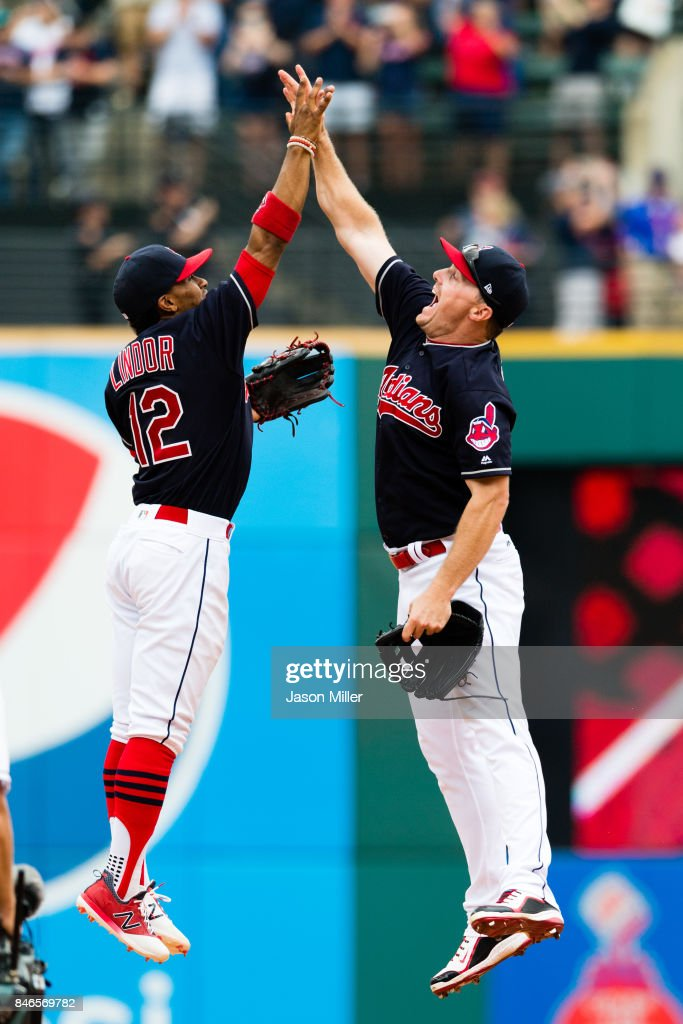 Francisco Lindor #12 celebrates with Jay Bruce #32 of the Cleveland Indians after the Indians defeated the Detroit Tigers at Progressive Field on September 13, 2017 in Cleveland, Ohio. The Indians defeated the Tigers to win 21 straight games.