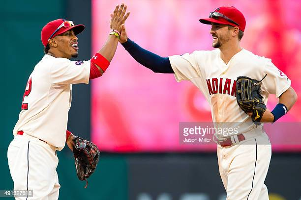 Francisco Lindor celebrates with Lonnie Chisenhall of the Cleveland Indians after the Indians defeated the Boston Red Sox at Progressive Field on...