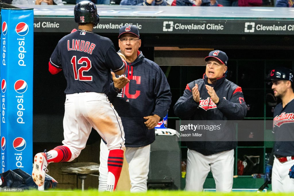 Francisco Lindor #12 celebrates with manager Terry Francona #17 and bench coach Brad Mills #2 of the Cleveland Indians after Lindor scored during the seventh inning against the Baltimore Orioles at Progressive Field on September 8, 2017 in Cleveland, Ohio.