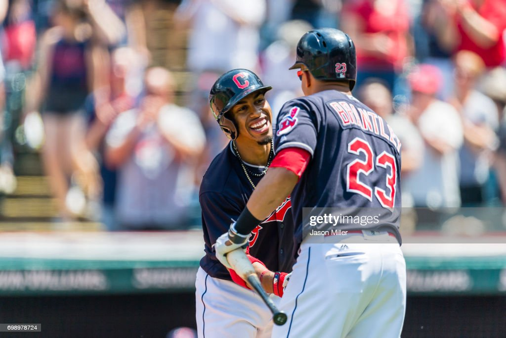 Francisco Lindor #12 celebrates with Michael Brantley #23 of the Cleveland Indians after Lindor hit a solo home run during the first inning against the Seattle Mariners at Progressive Field on April 30, 2017 in Cleveland, Ohio.