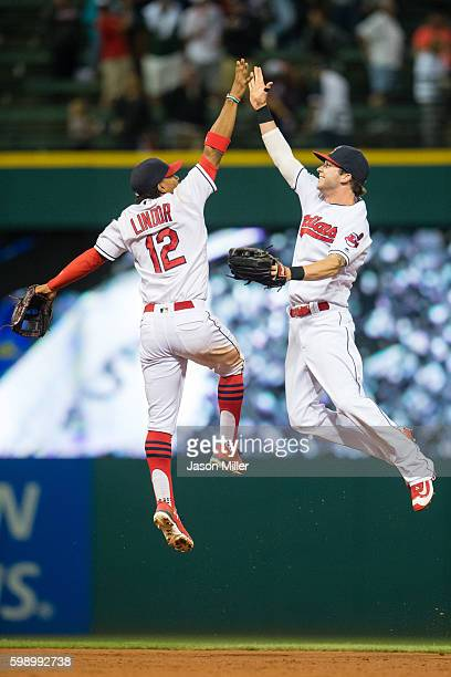 Francisco Lindor celebrates with Tyler Naquin of the Cleveland Indians after the Indians defeated the Miami Marlins during an interleague game at...