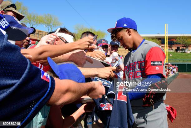 Francisco Lindor of Puerto Rico signs autographs prior to an exhibition game against the Colorado Rockies on March 9 2017 in Scottsdale Arizona
