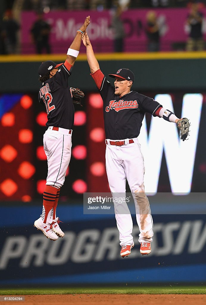 Francisco Lindor #12 of the Cleveland Indians and Brandon Guyer #6 celebrate after defeating the Boston Red Sox 6-0 in game two of the American League Divison Series at Progressive Field on October 7, 2016 in Cleveland, Ohio.