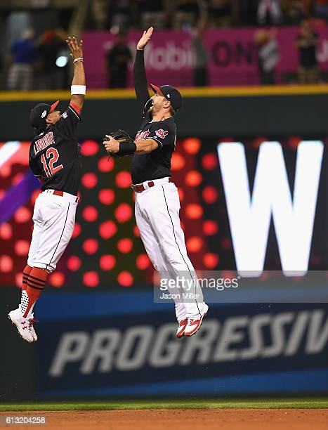 Francisco Lindor of the Cleveland Indians and Lonnie Chisenhall celebrate after defeating the Boston Red Sox 60 in game two of the American League...