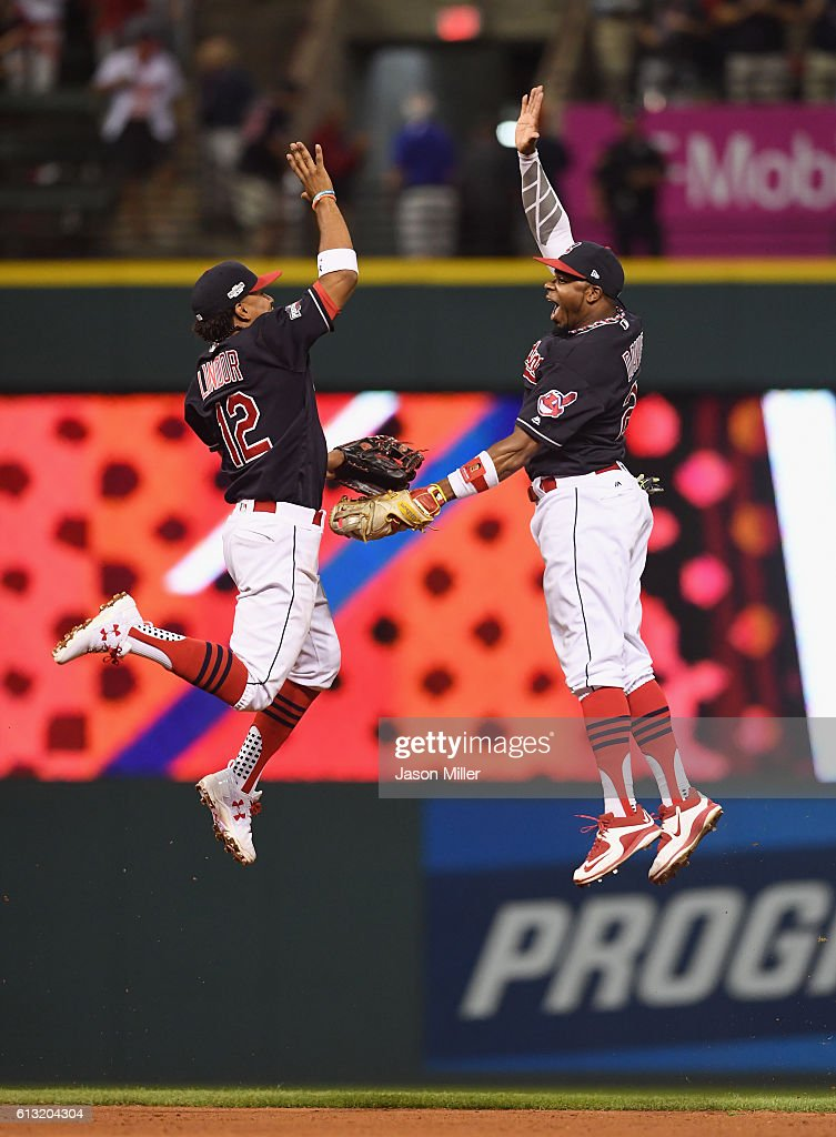 Francisco Lindor #12 of the Cleveland Indians and Rajai Davis #20 celebrate after defeating the Boston Red Sox 6-0 in game two of the American League Divison Series at Progressive Field on October 7, 2016 in Cleveland, Ohio.