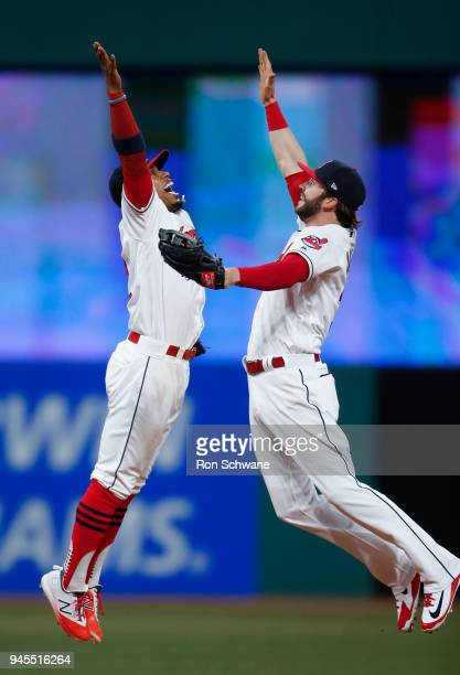 Francisco Lindor of the Cleveland Indians and Tyler Naquin celebrate a 93 victory over the Detroit Tigers at Progressive Field on April 12 2018 in...