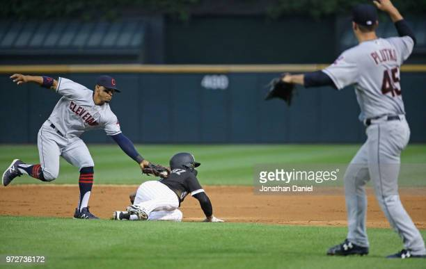 Francisco Lindor of the Cleveland Indians appears to tag out Yolmer Sanchez of the Chicago White Sox but Sanchez advanced on a balk by Adam Plutko in...