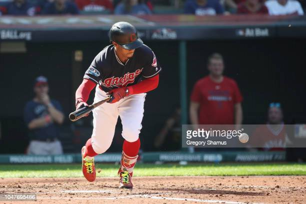 Francisco Lindor of the Cleveland Indians bunts in the third inning against the Houston Astros during Game Three of the American League Division...
