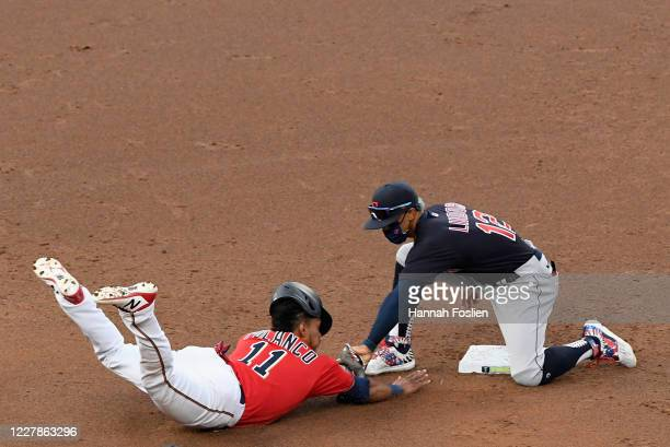 Francisco Lindor of the Cleveland Indians catches Jorge Polanco of the Minnesota Twins attempting to advance to second base during the second inning...