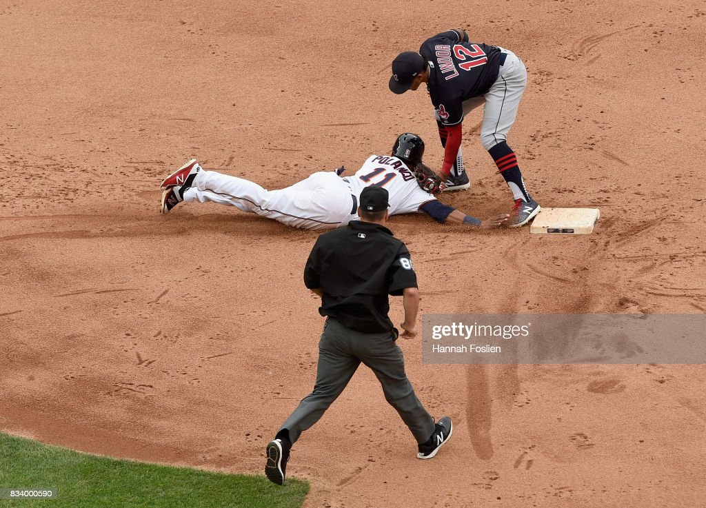 Francisco Lindor #12 of the Cleveland Indians catches Jorge Polanco #11 of the Minnesota Twins off second base as umpire David Rackley #86 looks on during the fifth inning in game one of a doubleheader on August 17, 2017 at Target Field in Minneapolis, Minnesota. The Indians defeated the Twins 9-3.