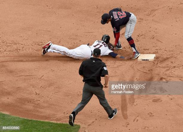 Francisco Lindor of the Cleveland Indians catches Jorge Polanco of the Minnesota Twins off second base as umpire David Rackley looks on during the...