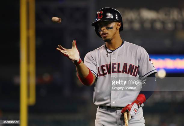 Francisco Lindor of the Cleveland Indians catches some pine tar to put on his bat while playing the Detroit Tigers at Comerica Park on May 14 2018 in...