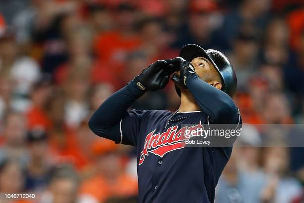 Francisco Lindor of the Cleveland Indians celebrates after hitting a solo home run off Gerrit Cole of the Houston Astros in the third inning during...