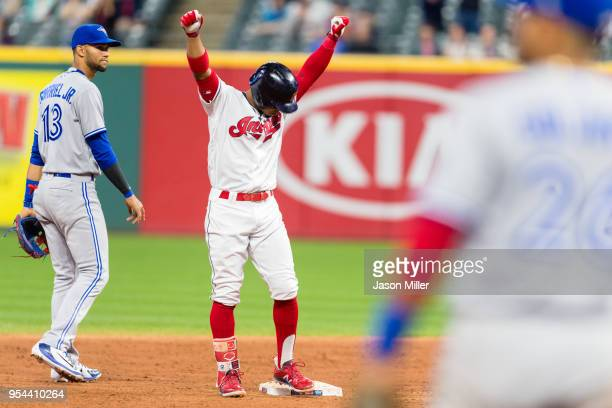 Francisco Lindor of the Cleveland Indians celebrates after hitting an RBI double during the fifth inning against the Toronto Blue Jays in game two of...