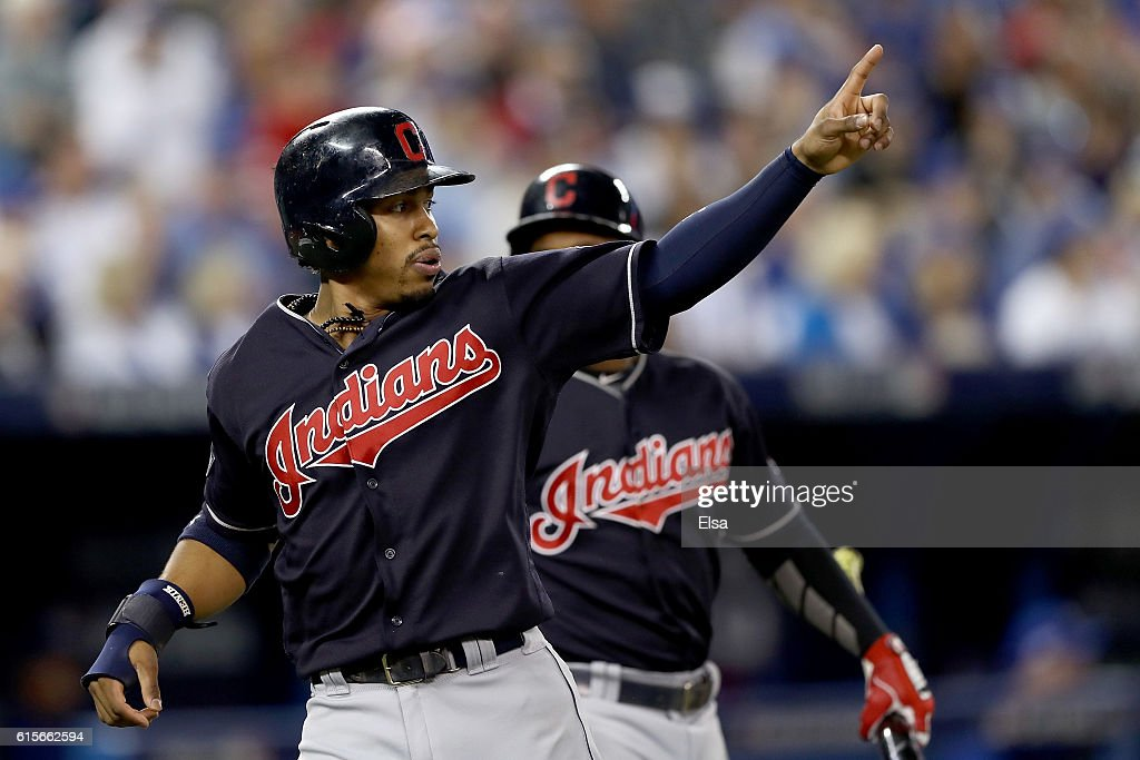 Francisco Lindor #12 of the Cleveland Indians celebrates after scoring a run off of a double hit by Mike Napoli #26 in the first inning against Marco Estrada #25 of the Toronto Blue Jays during game five of the American League Championship Series at Rogers Centre on October 19, 2016 in Toronto, Canada.