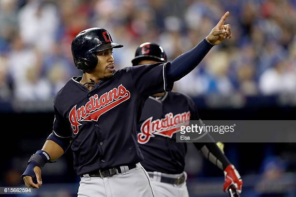 Francisco Lindor of the Cleveland Indians celebrates after scoring a run off of a double hit by Mike Napoli in the first inning against Marco Estrada...