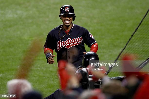 Francisco Lindor of the Cleveland Indians celebrates after scoring a run off of single hit by Jose Ramirez during the first inning against the...