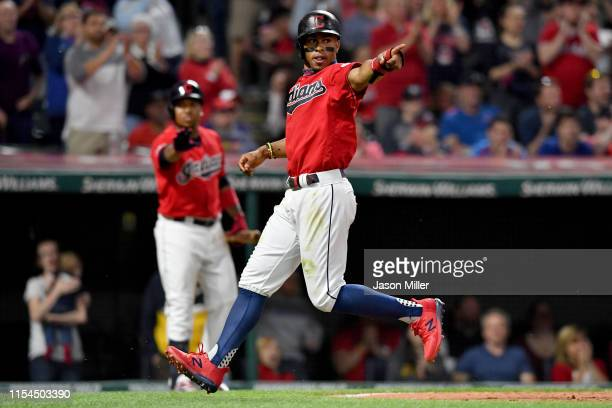 Francisco Lindor of the Cleveland Indians celebrates after scoring on a sacrifice fly by Jason Kipnis during the eighth inning against the New York...