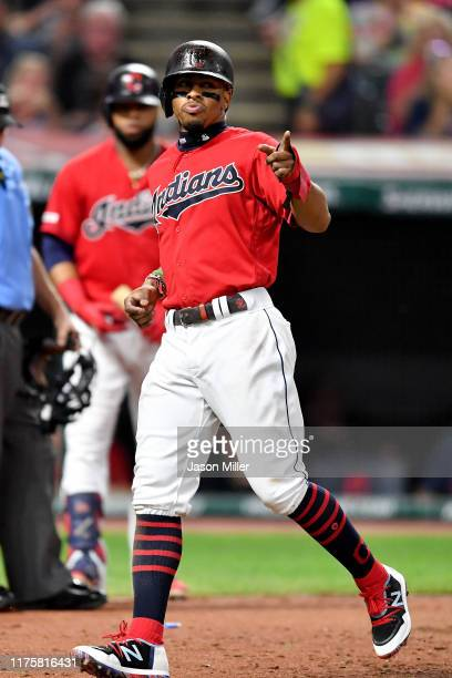 Francisco Lindor of the Cleveland Indians celebrates after scoring on a single by Oscar Mercado during the fifth inning against the Detroit Tigers at...