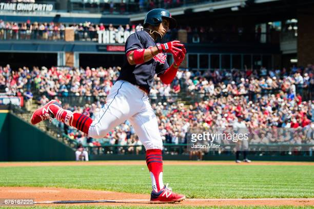 Francisco Lindor of the Cleveland Indians celebrates as he rounds the bases after hitting a solo home run during the first inning against the Seattle...