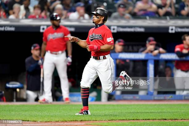 Francisco Lindor of the Cleveland Indians celebrates as he scores on a single by Oscar Mercado during the fifth inning against the Detroit Tigers at...