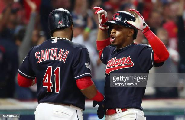 Francisco Lindor of the Cleveland Indians celebrates his grand slam with Carlos Santana in the sixth inning during game two of the American League...