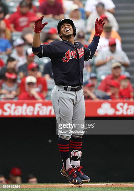 Francisco Lindor of the Cleveland Indians celebrates his solo homerun at homeplate in the first inning during the MLB game against the Los Angeles...
